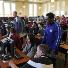 Weber State University President Wight and volunteers assist students during College Application Week to fill out college and scholarship applications.
